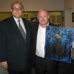 Former Astronaut Mark Kelly, husband of Gabrielle Giffords, acquiring one of Leving's paintings.